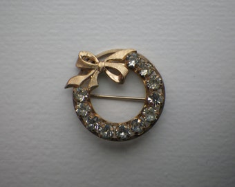 Gold Toned Circle Pin with Bow Accent and 11 Clear CZ's
