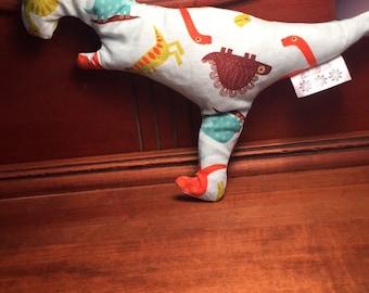The #ichoosejoy stuffed dinosaur
