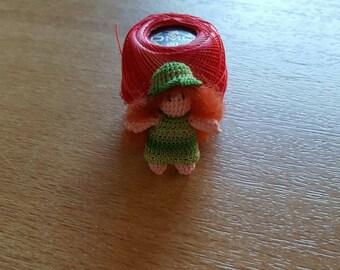 16023.  Miniature doll
