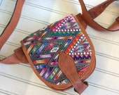 The perfect fanny pack/ travel pouch. Top grain leather travel pouch. Accented with handwoven Guatemalan tribal fabric. Multi purpose pouch.