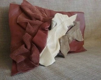 Dark red leather clutch bag with ruffle details