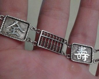 A Chinese silver abacus bracelet