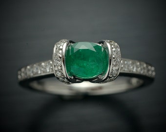 14kt white gold ring Fashion with a Natural green oval emerald .65ct  and 36 diamonds