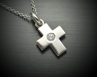 14kt white gold Cross pendant with a .10ct diamond