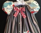 2T  Red, Gray, Turquoise Striped/Floral Jumper