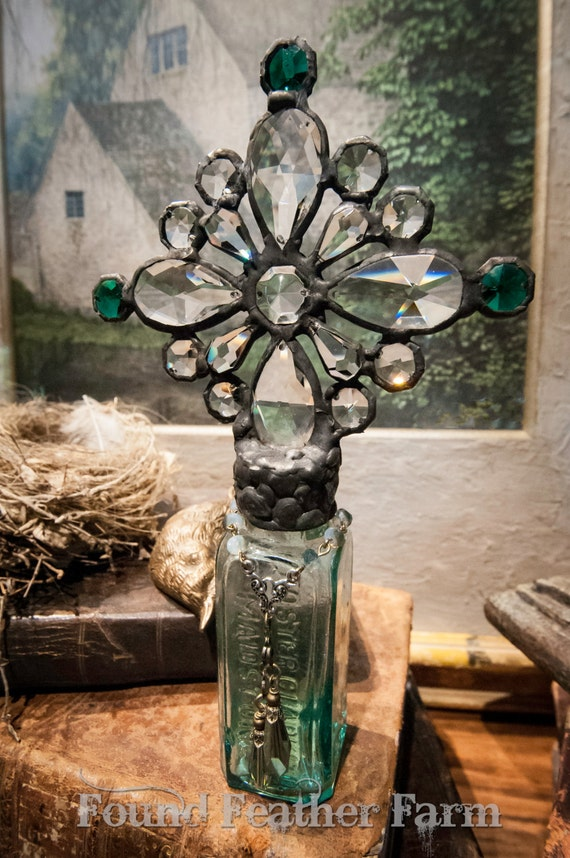 Handmade Glass Cross Bottle with a 1889 era World's Fair Antique Eiffel Tower Bottle
