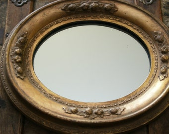 Midcentury Small Oval Mirror Ornately Styled with a Gold Finish