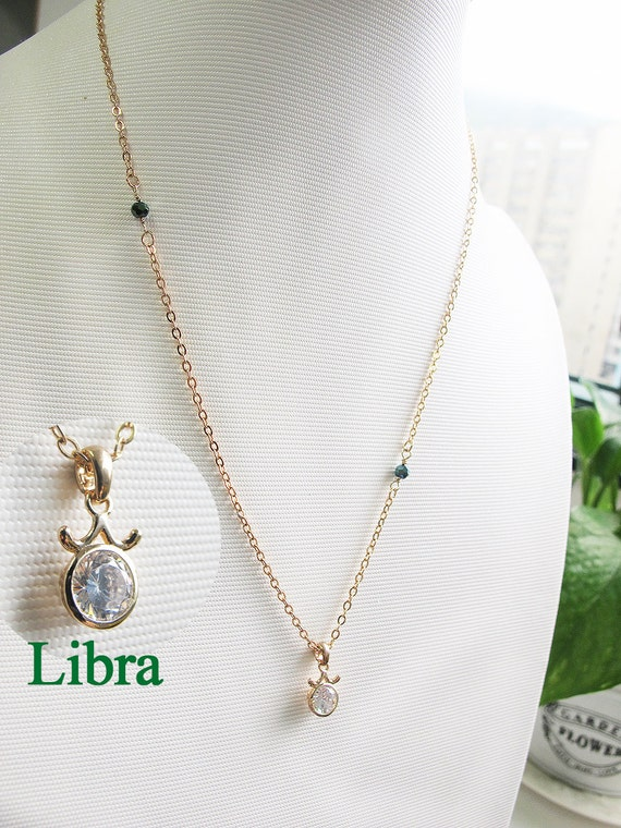 libra sign necklace zircon and 18 k gold by