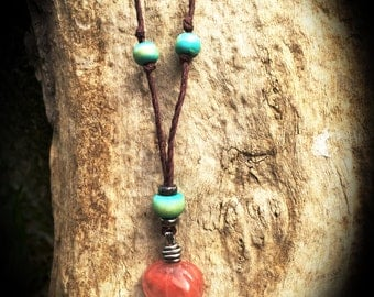 Rose quartz stone frog pendent on hemp cord with wooden beads.
