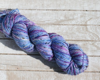 Hand dyed tweed yarn in blue and purple, hand dyed varigated tweed yarn aran weight, yarn for a warm hat that is hand dyed
