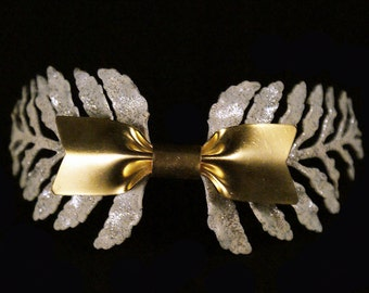 Athenais. Enameled brass tiara with a bow tie