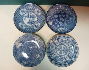 Takahashi set of 4 blue and white porcelain dishes