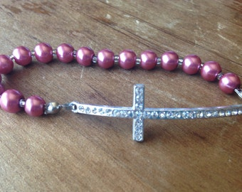 Crystal cross stretch bracelet with fuchsia glass pearls