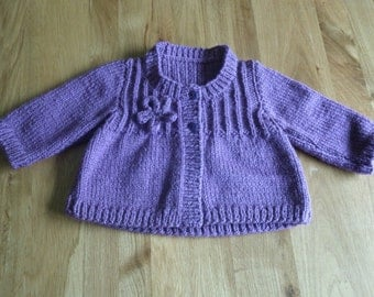 Hand knitted baby girls cardigan in purple, age 1/2 years