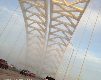 Cincinnati, Ohio - BigMac Bridge. Color photo of this icon of the Cincinnati skyline. Taken on a foggy morning with gleaming lighting.