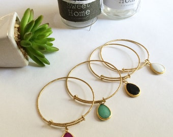 Gold gemstone bangle bracelet