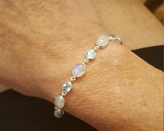 Sterling Silver, blue topaz and rainbow moonstone adjustable bracelet.