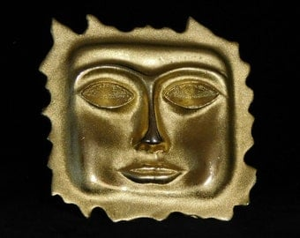 Sun face brooch