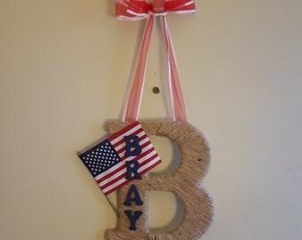 Patriotic twine wrapped letter door wreath