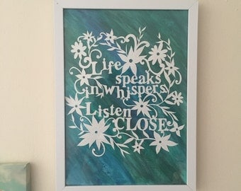 Hand drawn and hand cut papercut, with watercolour background