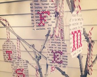 Sewn paper christmas gift tags