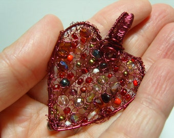 Beautiful knitted wire heart pendant with red coloured copper wire and glass and gemstone beads
