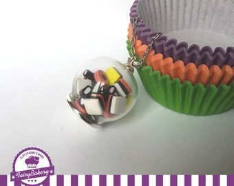 miniature allsorts liquorice in a bottle or globe vial. food jewelry. polymer clay food. sweets. candy.