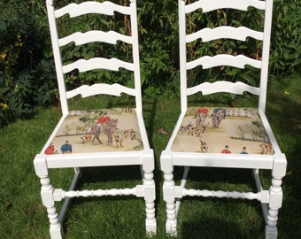 Pair of pretty vintage horse and hound linen fabric dinning chairs