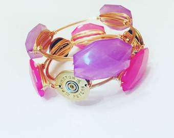 Bangle Bracelets with a Southern Bling, 3 Bracelets Pink, Purple, and Shotgun Shell on gold wire.