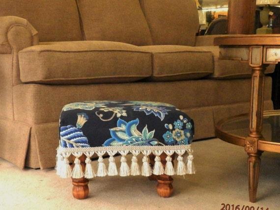 Floral upholstered footstool with cream fringe