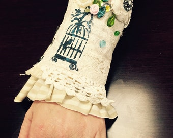 Victorian whimsical creme cuff, gold highlights, birdcage, blue/pink/floral fits 7 1/2-8 1/2""