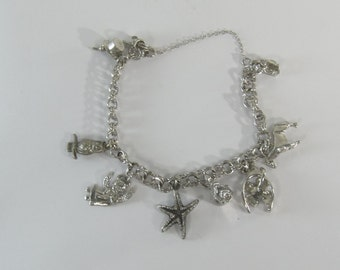 Vintage Sterling Silver Charm Bracelet with 7 Charms 7.5""