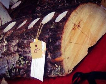 Rustic log decorative candle holder.