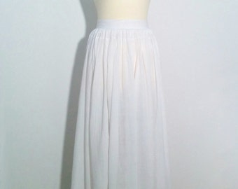 Antique White Cotton Full Length Skirt gathered at the waist and with pleated hem and borderie anglaise edge.