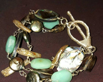 Mother of pearl.. Smokey Topaz... Jade, shell and spun sterling silver bracelet