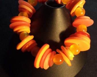 Orange button and catseye bead elasticated bracelet