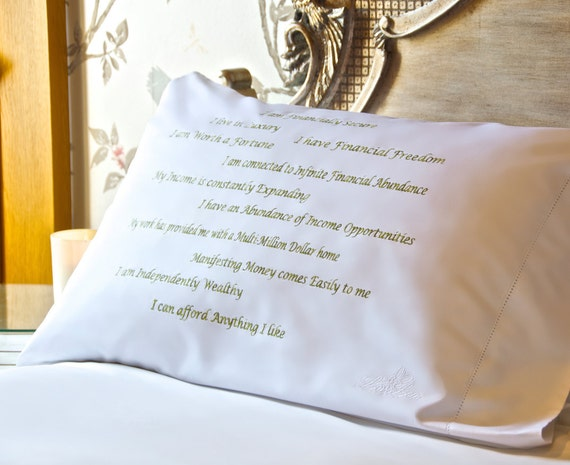 Abundant Wealth: Luxury, embroidered, affirmation pillowcase designed by actress Kirsten Lea