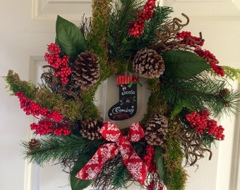 Moss Christmas Wreath with Berries and Pine Cones