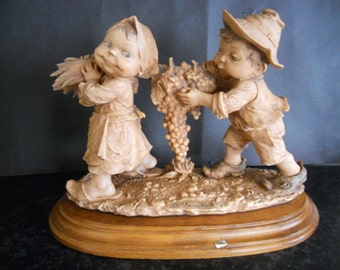 Giuseppe Armani Capodimonte Boy and Girl carrying Grapes. Gullivers World. Terracotta finish. 1980.