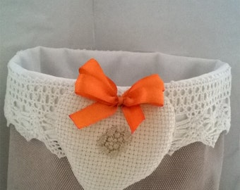 Shabby chic fabric basket with tatting and fabric decorations