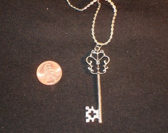 METAL KET PENDANT  comes with 18 inch sterling chain
