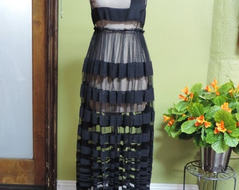 Black and sheer striped dress.