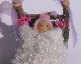 Handmade woodland bed with lace and pink flower fairy peg doll