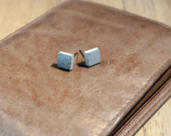 Square concrete earrings.