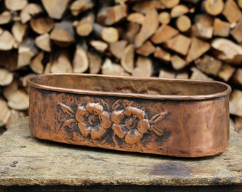 Copper flower pot with flowers hand chiseled