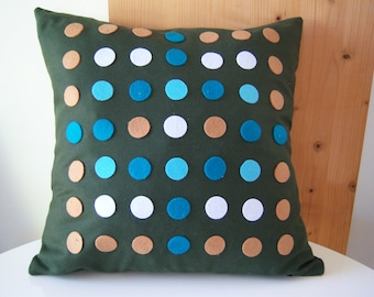blue and green dotted pillow