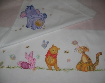 Crib sheet, painted and embroidered by hand.