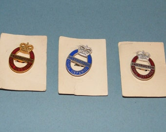 3 Post World War II late 1950's Great Britain Civil Defence Instructor badges by J R Gaunt of London (Queens Crown)