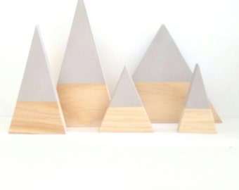 Moving mountains timber wooden triangle geometric scandi baby decor nursery shelfie interior design kids play room styling toddler toy inspo