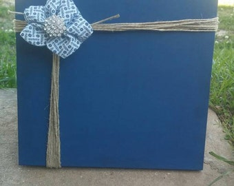 Handmade wooden picture holder made with twine, hand sewn flower, and a little bling!